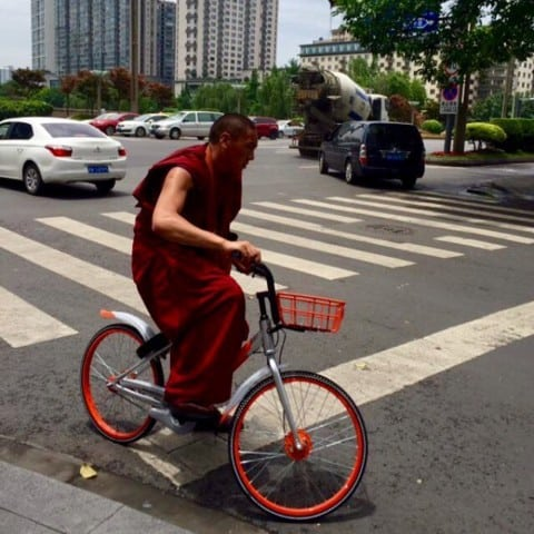 Cool photo of a monk on Mobike ??@erictsui